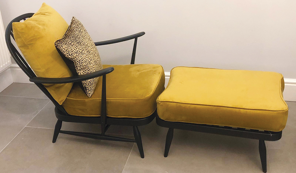 black sofa with gold cus with foot stool 1024px